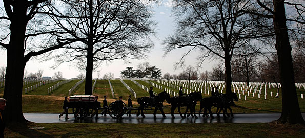 A horse-drawn caisson carries the casket of Army Maj. Alan Greg Rogers to his burial service at Arlington National Cemetery on March 14.