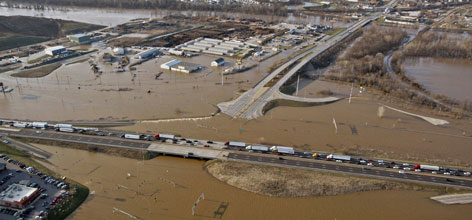 Interstate 44 is seen as flood waters engulf parts of an interchange near the Meramec River, Friday afternoon, over Fenton, Mo.
