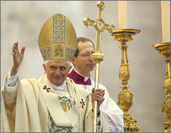 Pope Benedict XVI blesses the people as he delivers his Easter benediction.