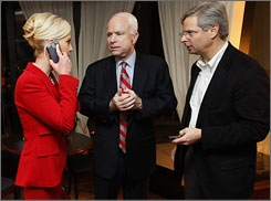 Sen. John McCain speaks with wife Cindy and campaign manager Rick Davis in January. As a lobbyist, Davis represented Bellsouth, SBC Communications and Verizon Corporate Services.