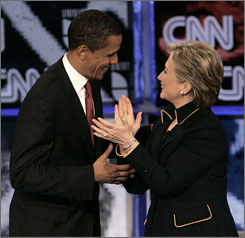 Sen. Barack Obama and Sen. Hillary Clinton talk after the Texas Democratic Party's presidential candidates debate in Austin in February. A recent poll of Democrats and independents who lean toward the party indicated that 45% would find an Obama-Clinton ticket acceptable and 44% would approve of the reverse.