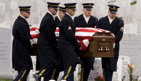 An Army honor guard carries the casket of Army Spc. Luke Runyan during funeral services at Arlington National Cemetery in Arlington, Va., on March 10. Runyan, of Spring Grove, Pa., was killed by small arms fire Feb. 17 in Iraq's Diyala Province.