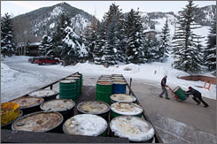 In the early morning hours, Brian Flynn, left, and partner Forrest Fulker collect barrels of used cooking oil from restaurants in Aspen, Basalt and El Jebel, Colo. Flynn recycles the oil as fuel for his truck, which he altered to run on vegetable oil, and sells it to biodiesel producers.