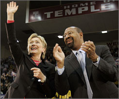 Sen. Hillary Rodham Clinton and Philadelphia Mayor Michael Nutter react to the crowd during a campaign stop at Temple University in Philadelphia, March 11. Nutter, who entered politics during former President Bill Clinton's term, said he appreciates Sen. Clinton's understanding of urban America.