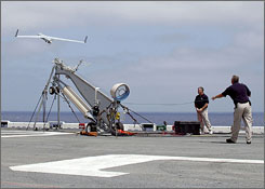 ScanEagle launches from a pneumatic wedge catapult launcher on the flight deck aboard the amphibious assault ship USS Saipan in the Atlantic Ocean, in 2006.