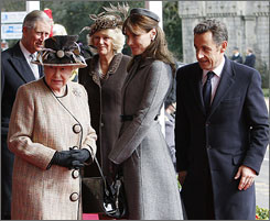French President Nicolas Sarkozy, right, and first lady Carla Bruni, second right, are greeted by Britain's Queen Elizabeth, left, followed by Prince Charles and Camilla, Duchess of Cornwall, in Windsor, England, Wednesday.
