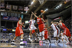 Courtside view: The Louisville Cardinals play the Connecticut Huskies last March at the Hartford Civic Center. City officials are seeking support to replace the center.
