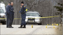 Virginia State Police investigate a shooting near Crozet, Va., on Thursday. Two persons were wounded and at least four vehicles were hit by gunfire in a series of incidents that began shortly after midnight.