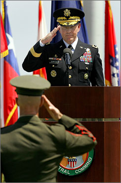 U.S. Army Lt. Gen. Martin Dempsey, top, salutes Sgt. Maj. Jeffrey Morin, during a Relinquishment of Command ceremony Friday, at MacDill Air Force Base in Tampa. Dempsey takes over Centcom after Navy Adm. William Fallon relinquished his post one year into the assignment.