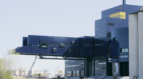 Jean Nouvel's designs include the Guthrie Theater , located near the Mississippi River in Minneapolis.
