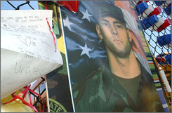 A letter hangs from a memorial at Glen Este High School in honor of Sgt. Keith Matthew Maupin, in this June 29, 2004 photo, near Batavia, Ohio.