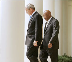 President Bush and HUD Secretary Alphonso Jackson walk in the Rose Garden of the White House in this Aug. 2007 photo. Under pressure from Democrats and with the housing sector in crisis, Jackson is resigning.