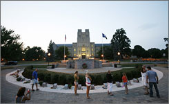 Virginia Tech students look over the permanent memorial for the slain students and faculty at the school in Blacksburg, Va. on Aug. 21, 2007.