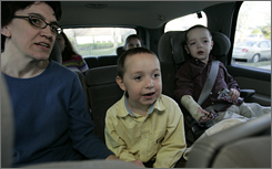 Jeanette O'Donnell rides with sons Patrick, 5, and Kiernan, 4, on the way to school in March 2005. Five of the six O'Donnell children have been diagnosed with various forms of autism.