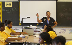 Baltimore Talent Development High School math teacher Mary Robinson teaches a lesson aimed at helping her 9th graders pass an algebra test in June 2007. According to the EPE Research Center, the city's public school system had a graduation rate of 34.6% during the 2003-04 school year.