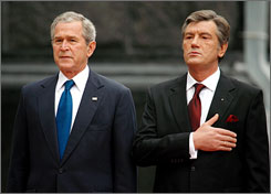 President Bush and Ukraine's President Viktor Yushchenko, right, listen to Ukraine's national anthem at an official welcoming ceremony in Kiev Tuesday.