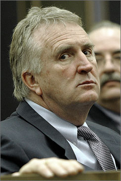 Judge Ernest B. Murphy waits in the courtroom during a recess in his libel suit against the Boston Herald Feb 11, 2005.
