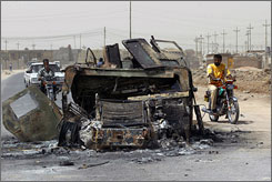 An Iraqi Army Humvee destroyed in fighting with Shiite militia sits in on a road in Basra on Wednesday.