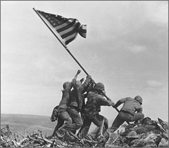 U.S. Marines of the 28th Regiment of the Fifth Division raise the American flag atop Mt. Suribachi, Iwo Jima, Feb. 23, 1945.