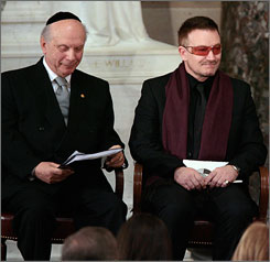 Rabbi Arthur Schneier, left, attends a memorial service for fellow Holocaust survivor Rep. Tom Lantos, D-Calif., at the U.S. Capitol on Feb. 14, accompanied by singer and activist Bono.