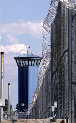 A guard tower is seen behind the wire fence that surrounds California State Prison, Sacramento, in Folsom, Calif. A panel of federal judges will consider whether crowding in the prison system has become so severe that the state must cap the inmate population or release some prisoners early.