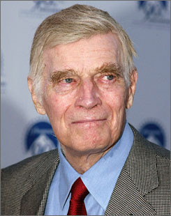 Chartlon Heston, seen here in July 2002, died at home Saturday evening at the age of 84. His wife, Lydia, was by his side at the time of his death.