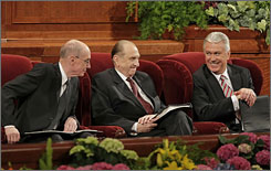 Mormon President Thomas Monson, center, First Counsellor Henry Eyring, left, and Second Counsellor Dieter Uchtdorf, right, confer Sunday before the start of the fourth session of the 178th Annual General Conference of the Mormon Church in Salt Lake City, Utah.  This is Monson's first conference as president of the Mormon Church.