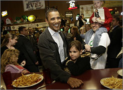Democratic presidential hopeful Sen. Barack Obama smiles as he talks to people at the M & M Cafe in Butte, Mont., Saturday. His opponent, Sen. Hillary Clinton, also was in Montana on Saturday.