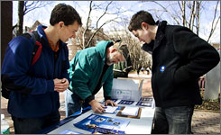 Young Obama student volunteers Mike Stratta, left, and Christo Logan, right, assist University of Pennsylvania worker Dave Munson, 45, fill up a voter registration form on the University of Pennsylvania campus in Philadelphia March 20.