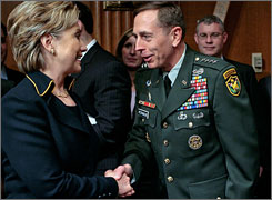 U.S. Army Gen. David Petraeus, right, commander of U.S. forces in Iraq, talks with Democratic presidential hopeful Sen. Hillary Clinton, D-N.Y., before his testimony to the Senate Armed Services Committee in Washington on April 8.