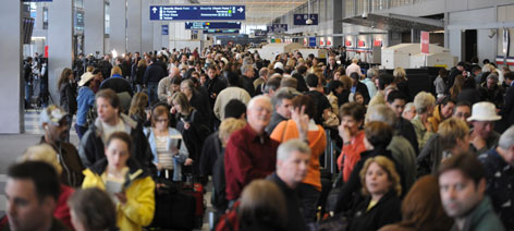 At Chicago's O'Hare Airport on Wednesday at least 100 travelers stood in line to rebook their flights.