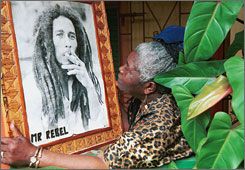 Cedella Booker holding a portrait of her late son, reggae legend Bob Marley, in May 2001 during the 20th anniversary of his death, at her home in St. Ann's Parish, Jamaica. Booker died Tuesday at her home in Miami.