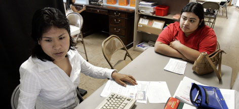 Martha Pantoja, left, helps Iris Castillo Ortiz prepare her income taxes at a community center in Nashville Pantoja has been helping Hispanic immigrants in Nashville this tax season as a volunteer tax preparer for a United Way program. 