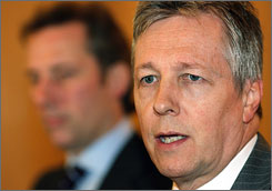 Democratic Unionist party leader Peter Robinson, right, and Ian Paisley Jr., left, during a November 2006 press conference in Belfast, Northern Ireland. Robinson is expected to become the new Protestant leader in Northern Ireland, succeeding the senior Paisley.
