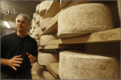Mateo Kehler of Jasper Hill Farm checks aging cheese made from raw milk in Greensboro, Vt. The raw milk is what gives the cheese its distinct flavor, which varies from summer to winter depending on if the cows are eating grass in the pasture or hay.