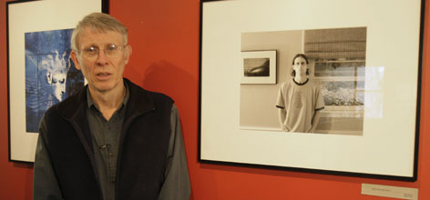 Michael Bishop, father of Jamie Bishop, a German teacher killed in the Virginia Tech massacre, poses next to Jamie's self portrait at an exhibit at LaGrange College. Bishop is working to get an international peace center established at Virginia Tech.