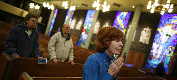 Jackie Campbell worships at Immaculate Conception Catholic Church in Chicago on Thursday.