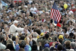 A U.S. flag is seen as Pope Benedict XVI is driven through the crowd during his weekly general audience in St. Peter's Square, at the Vatican. The pontiff will be in America this coming week.