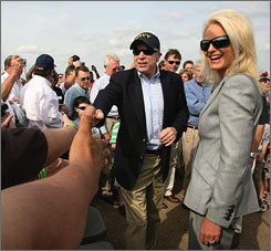 "Republican presidential candidate, Sen. John McCain, R-Ariz., center, accompanied by his wife, Cindy McCain, right, greets the crowd at the ""Wings over Meridian"" Air Show at the McCain field on the Meridian Naval Air Station March 30 in Meridian, Miss."