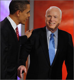 Democratic presidential hopeful Barack Obama, the senator from Illinois, left, and Republican presidential hopeful John McCain, the senator from Arizona, on stage between debates in Manchester, N.H., on Jan. 5.
