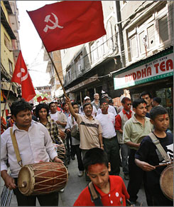 Communist Party of Nepal (Maoist) supporters shout party slogans during a victory rally for one of their candidates in elections in Katmandu, Nepal, on Monday.