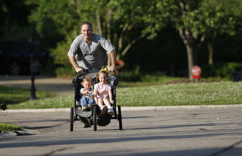 """The more you do, the more you benefit"": Exercise researcher Timothy Church gets in a jog while pushing his children, Lucy Jean, 5, and Charlie, 3, around their neighborhood in Baton Rouge. In Move Yourself, Church and his colleagues emphasize the benefits of even a little exercise, which reduces risky belly fat."