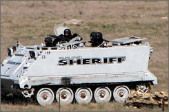 An armored personnel carrier moves outside the Yearning For Zion ranch near Eldorado, Texas in a photo by an unidentified member of the Fundamentalist Church of Jesus Christ of Latter Day Saints.