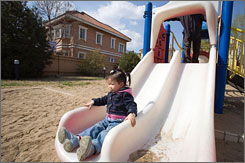 """A little Chinese girl plays in the playground of the """"Beijing Riviera,""""  a housing development in northern Beijing. Suburbia is no longer solely an American phenomenon."""