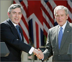 President Bush and British Prime Minister Gordon Brown shake hands after taking part in a joint news conference April 17 in the Rose Garden of the White House.