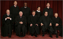 "A ""class photo"" shows the current Supreme Court justices, front row from left: Anthony Kennedy, John Paul Stevens, Chief Justice John Roberts, Antonin Scalia and David Souter. Back row, from left: Stephen Breyer, Clarence Thomas, Ruth Bader Ginsburg and Samuel Alito."