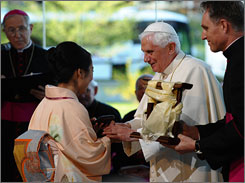 Masako Fukata, a Japanese Buddhist representative, gives Pope Benedict XVI a gift on on Thursday during an interfaith meeting at the John Paul II Cultural Center in Washington.