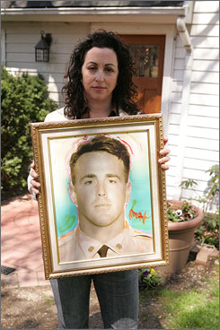 Marian Fontana holds a portrait of her husband, Dave, a firefighter killed in the World Trade Center attacks on Sept. 11, 2001, outside of her home on Staten Island on April 14.