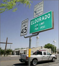 A welcome sign indicating a population of 1,951 greets drivers to the town of  Eldorado, Texas. The west Texas community finds itself at the geographic center of a growing controversy surrounding a polygamist sect established on a ranch in the rugged the landscape just north of town.