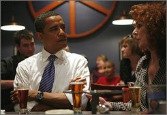 Sen. Barack Obama talks with brewery owner Peg Fegley during a visit to the Bethlehem Brew Works in Bethlehem, Pennsylvania, April 20. Pennsylvania will hold its primary vote on April 22.